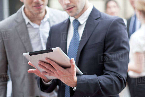 Businessman showing colleague digital tablet Royalty-free stock photo