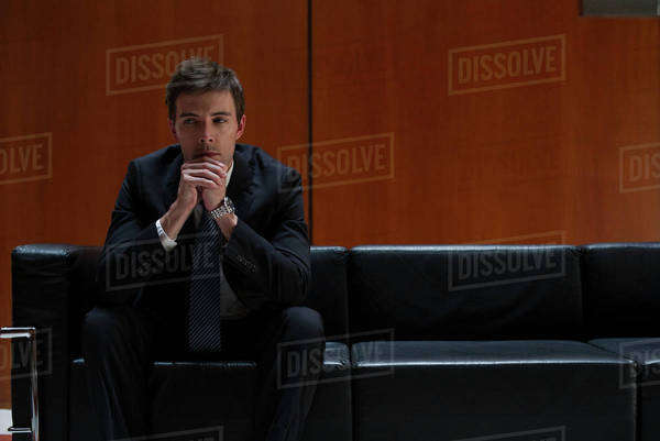 Businessman waiting anxiously for appointment Royalty-free stock photo