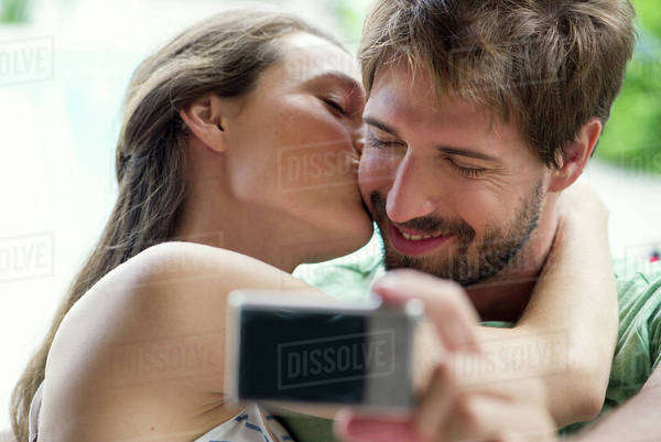 Couple kissing and taking selfie Royalty-free stock photo