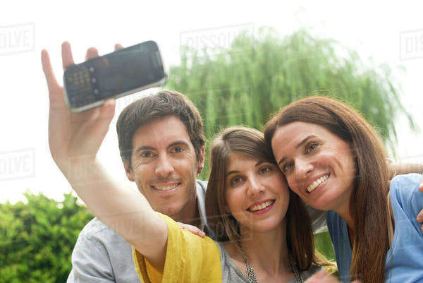 Young woman taking selfie with parents Royalty-free stock photo