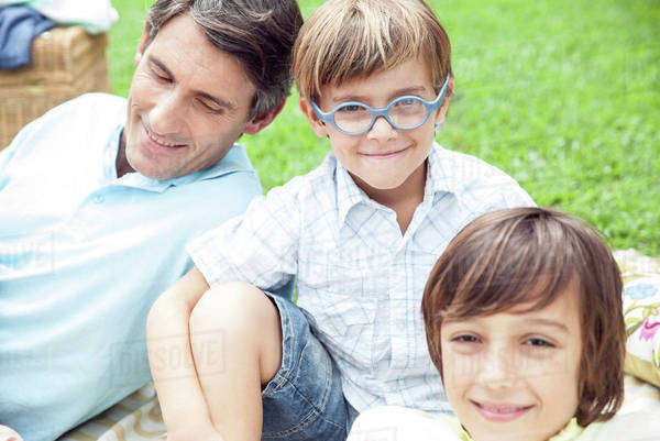 Boys spending time with father outdoors Royalty-free stock photo