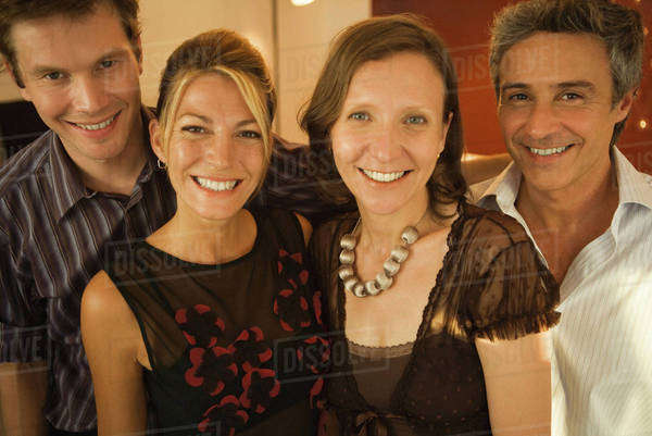 Four adult friends smiling at camera, group portrait Royalty-free stock photo