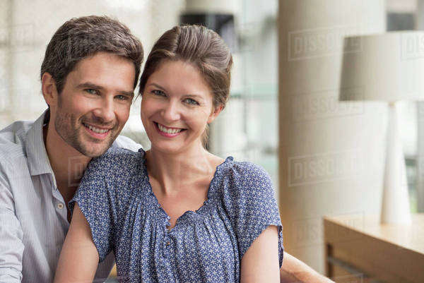Couple smiling together at home, portrait Royalty-free stock photo