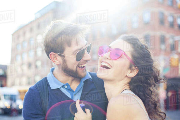 Couple laughing together outdoors Royalty-free stock photo