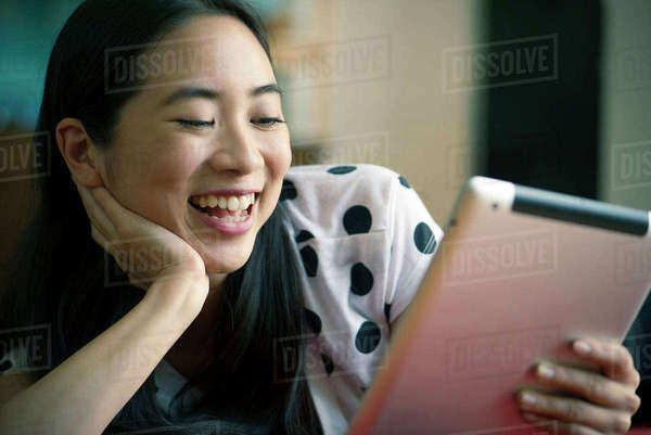 Young woman watching movie on digital tablet Royalty-free stock photo