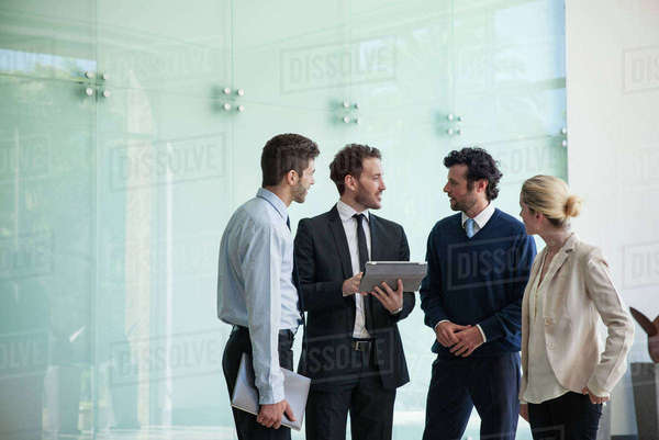 Business associates collaborating using digital tablet Royalty-free stock photo
