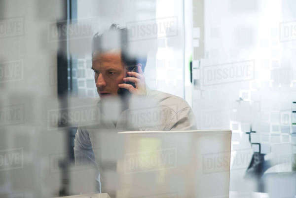 Man using office telephone Royalty-free stock photo