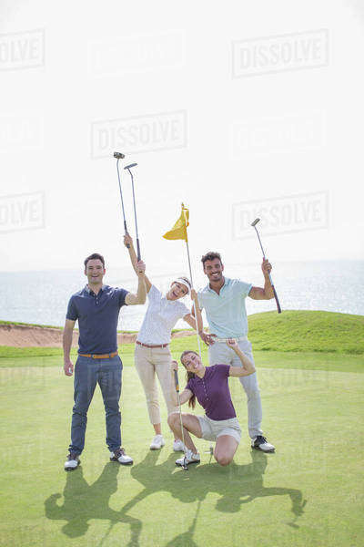 Playful friends on golf course Royalty-free stock photo