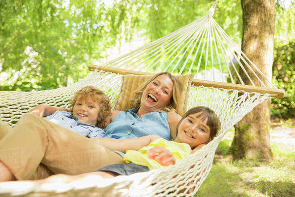 Mother and children relaxing in hammock Royalty-free stock photo