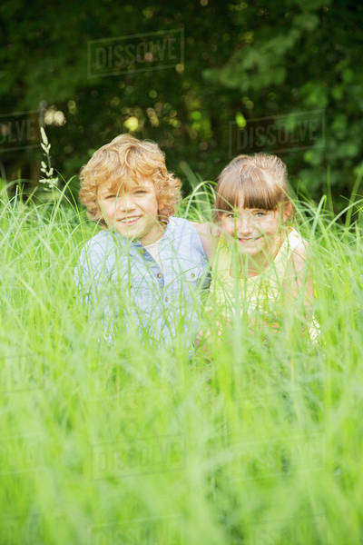 Children playing in tall grass Royalty-free stock photo