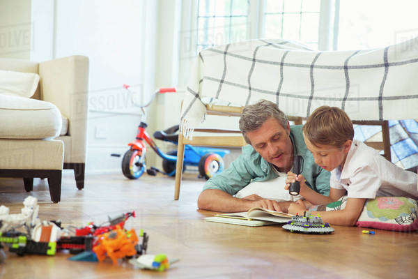 Father and son reading together Royalty-free stock photo