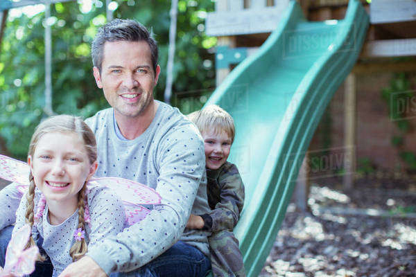 Father and children playing on play structure Royalty-free stock photo