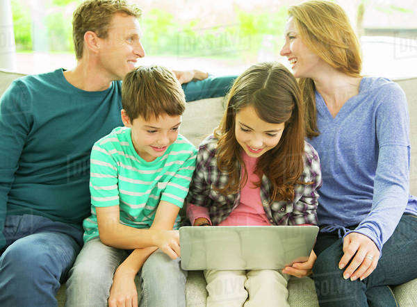 Family relaxing together on sofa Royalty-free stock photo