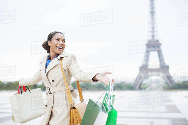 Woman carrying shopping bags by Eiffel Tower, Paris, France Royalty-free stock photo