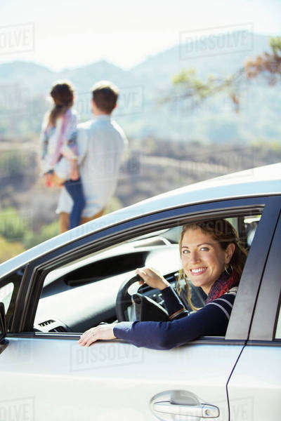 Portrait of smiling woman inside of car Royalty-free stock photo