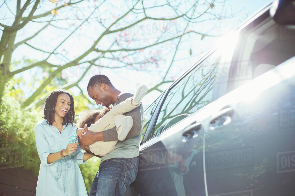 Happy family outside car Royalty-free stock photo