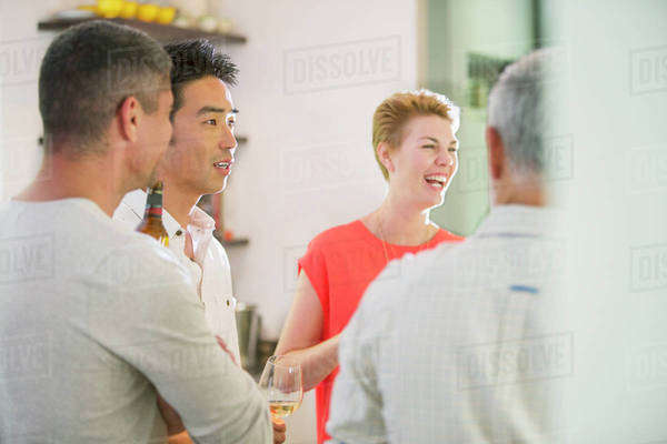 Friends talking at party Royalty-free stock photo