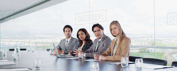 Portrait of confident business people at table in conference room Royalty-free stock photo
