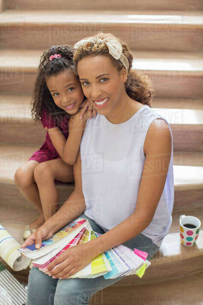 Mother and daughter looking through color swatches together Royalty-free stock photo