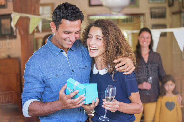 Couple opening gift together Royalty-free stock photo