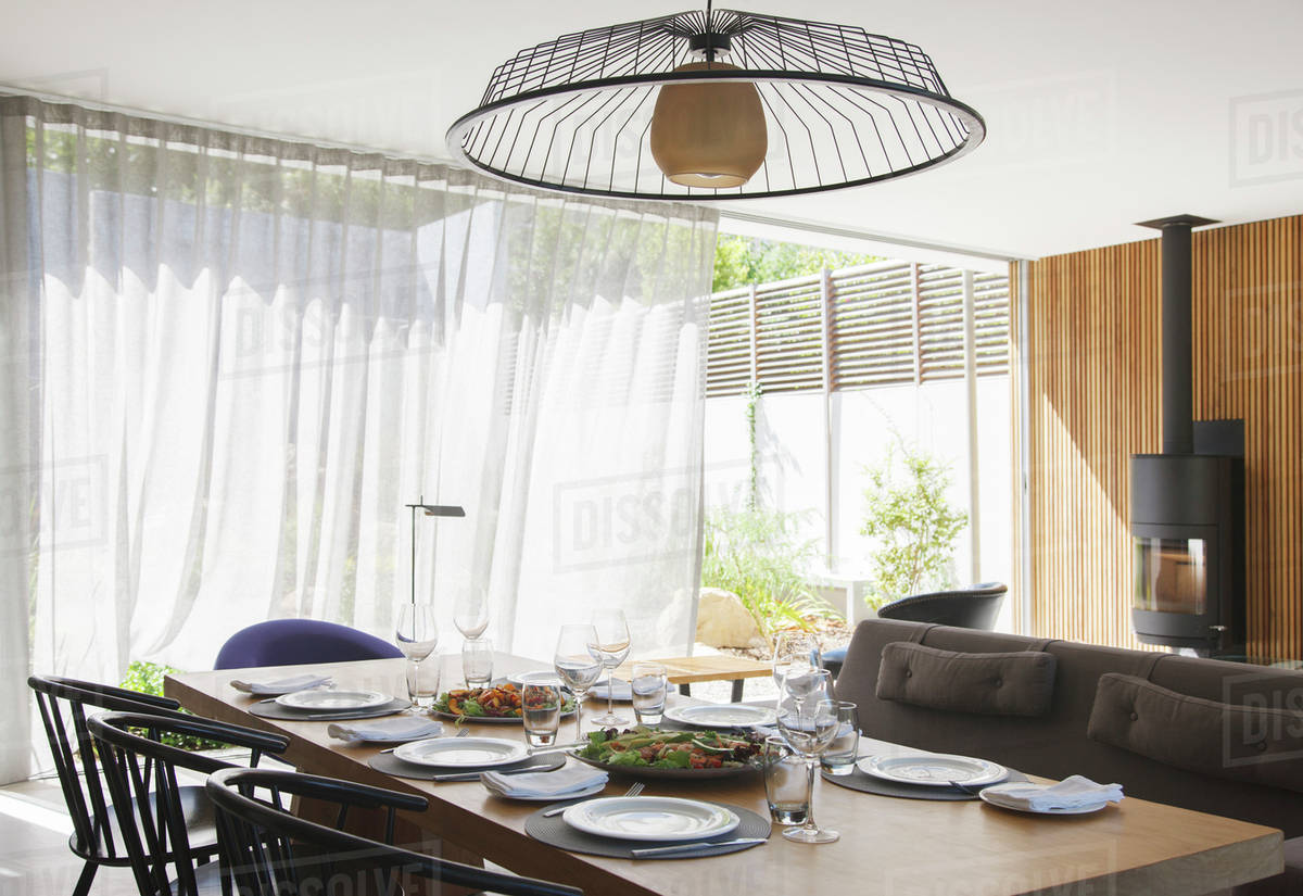 Chandelier over dining table in modern dining room D985_20_997