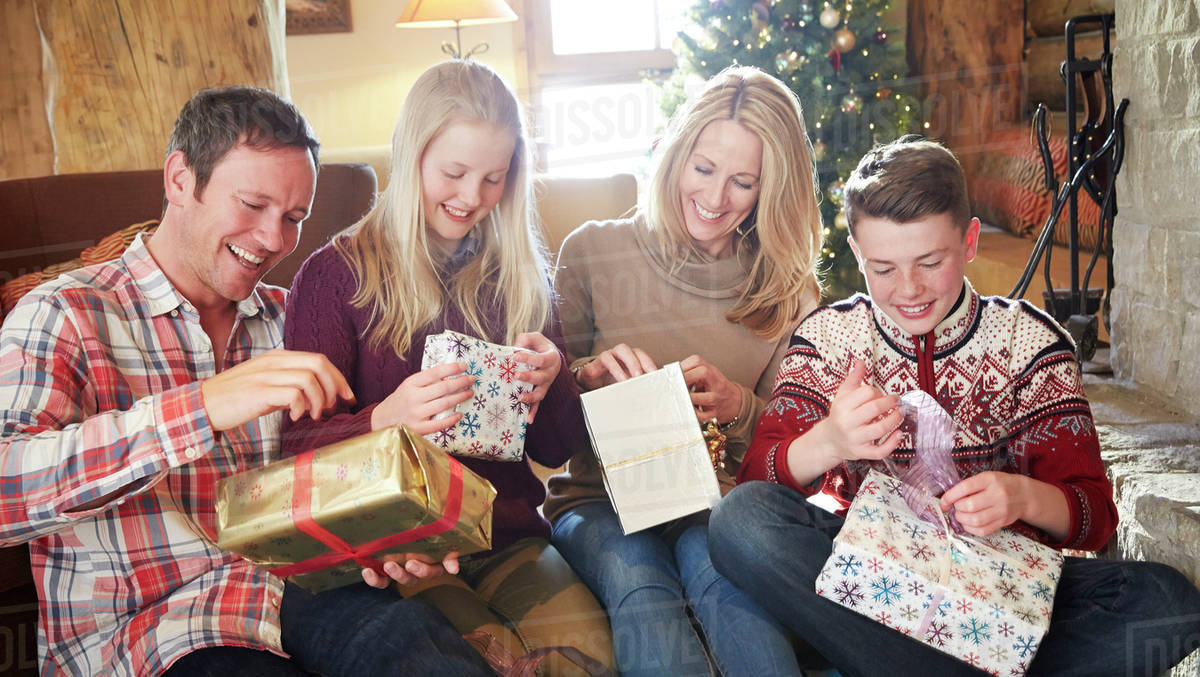 Family opening gifts on Christmas - Stock Photo - Dissolve