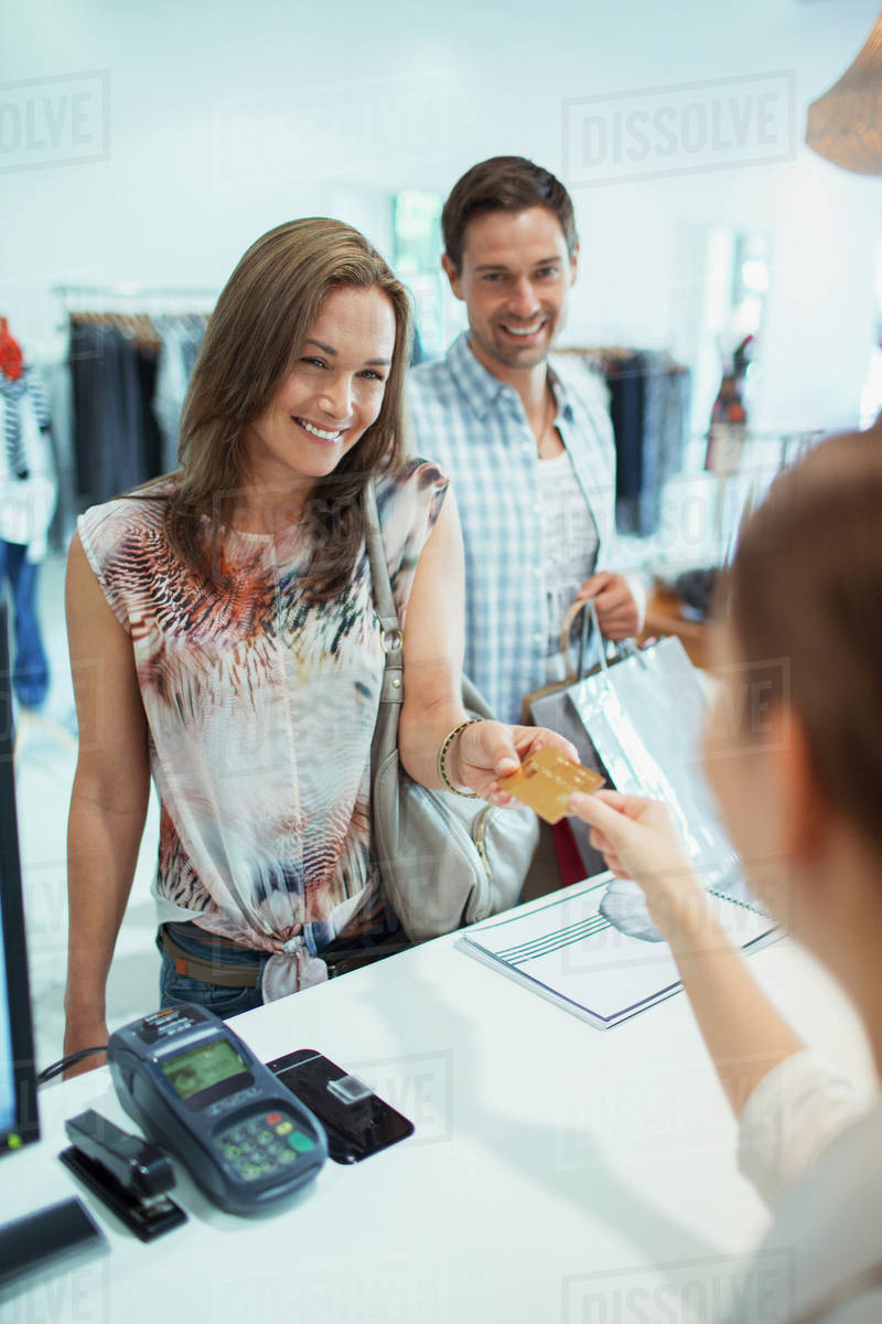 Woman Paying With Credit Card In Clothing Store Stock Photo Dissolve