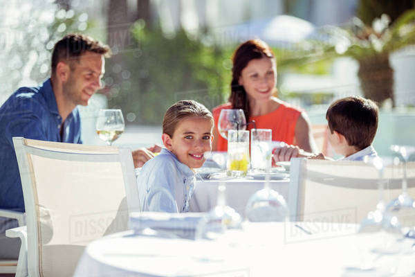 Family with two children having dinner in resort outdoors Royalty-free stock photo