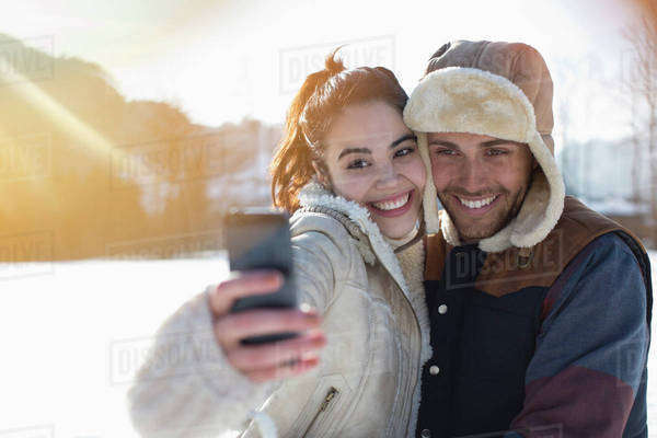 Couple taking selfie in snow Royalty-free stock photo