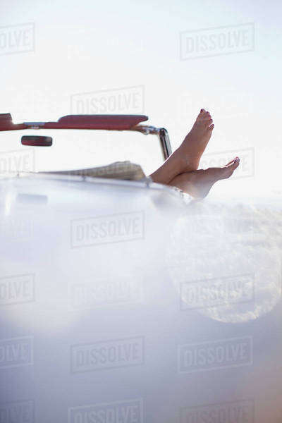 Woman's feet resting on convertible Royalty-free stock photo