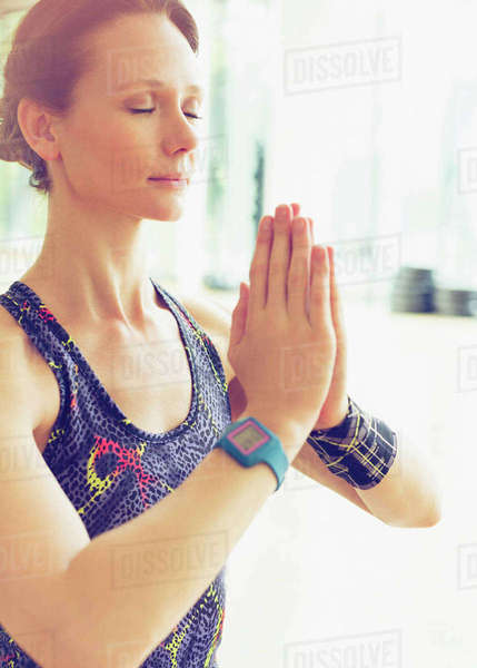 Serene woman practicing yoga with hands clasped Royalty-free stock photo