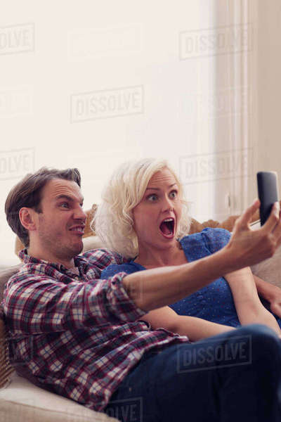 Playful couple making faces taking selfie Royalty-free stock photo