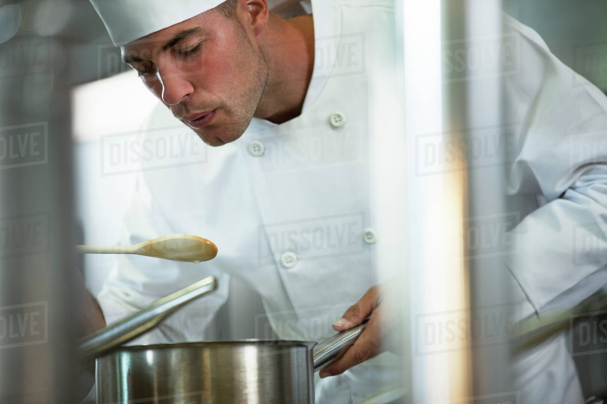 Chef tasting food in restaurant kitchen - Stock Photo - Dissolve