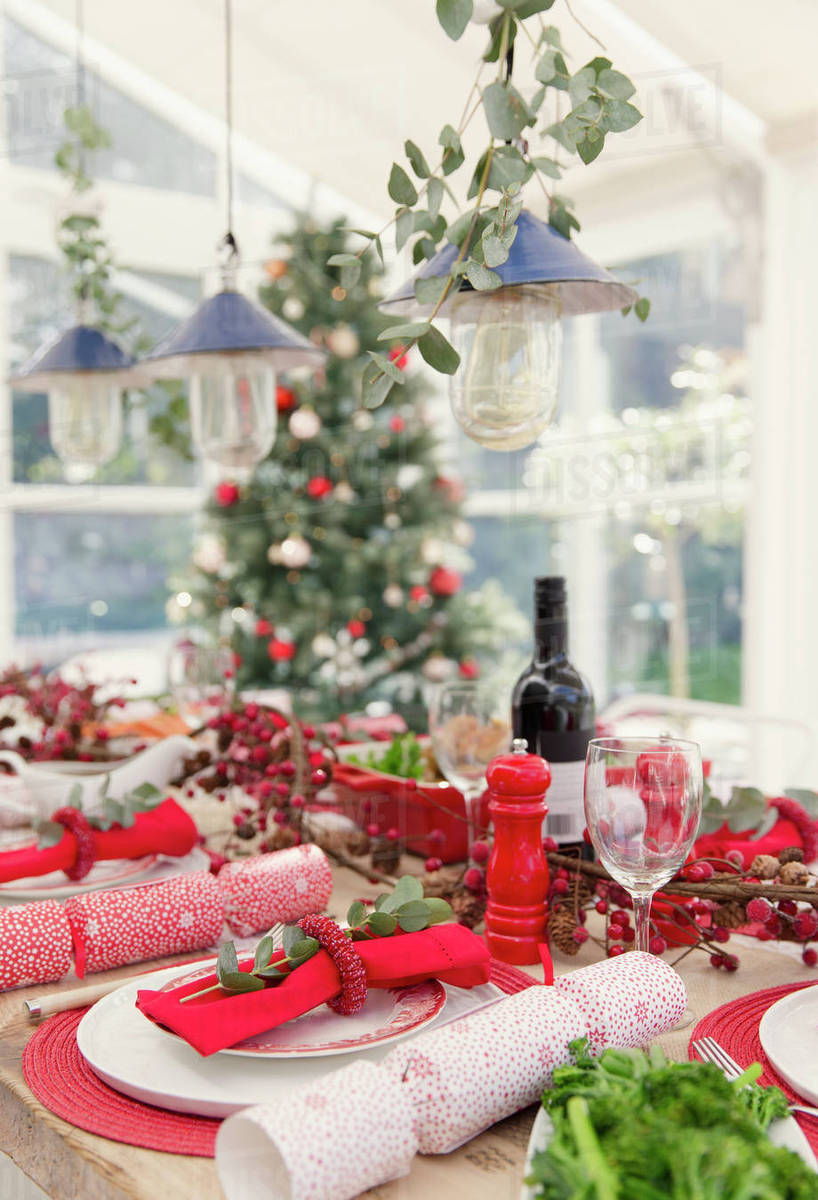 Placesetting And Christmas Decorations On Dining Table Stock Photo