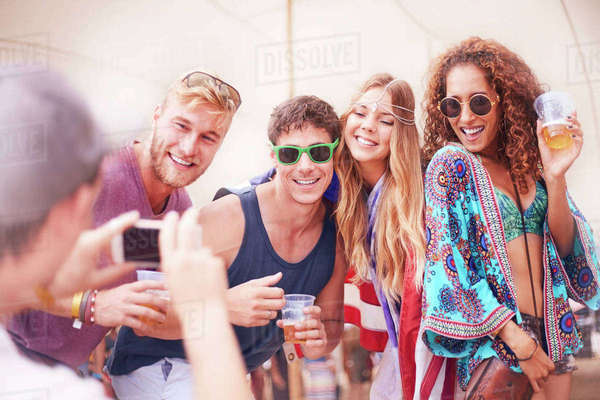 Young friends with beer posing for camera phone at music festival Royalty-free stock photo