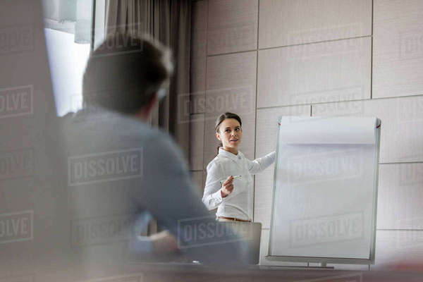 Businesswoman leading meeting at flipchart in conference room Royalty-free stock photo