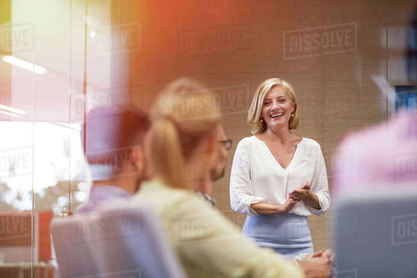 Smiling businesswoman leading meeting in conference room Royalty-free stock photo