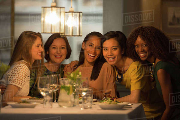 Portrait smiling women friends dining at restaurant table Royalty-free stock photo