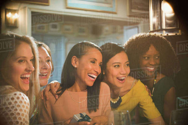 Smiling women friends celebrating birthday in restaurant Royalty-free stock photo