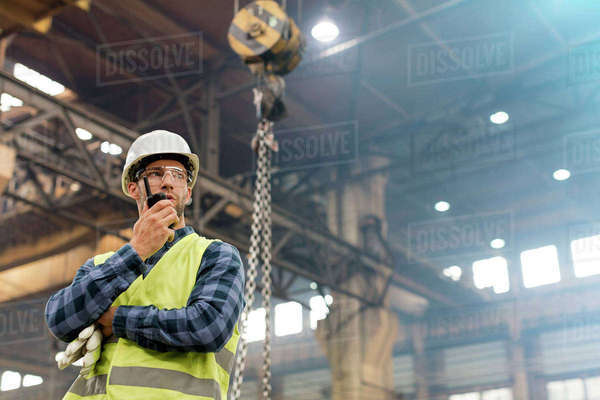Steel worker with walkie-talkie in factory Royalty-free stock photo