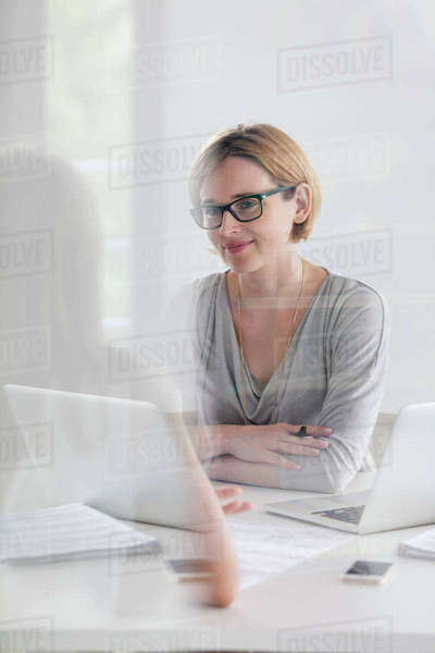 Portrait confident businesswoman working at laptop Royalty-free stock photo