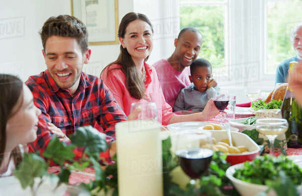Portrait smiling woman enjoying Christmas dinner with family at table Royalty-free stock photo