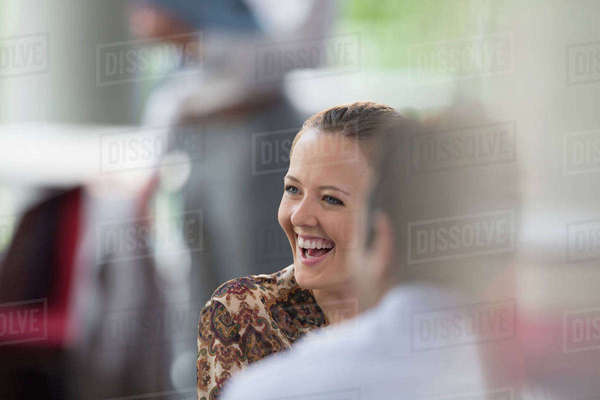 Businesswoman laughing in meeting Royalty-free stock photo