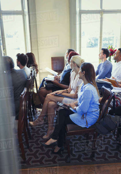 Attentive business people listening in business conference audience Royalty-free stock photo