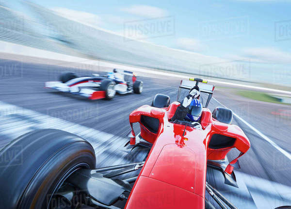 Formula one race car crossing finish line on sports track Royalty-free stock photo