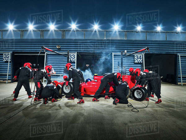 Pit crew working on formula one race car in pit stop Royalty-free stock photo