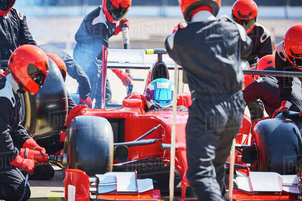 Pit crew working on formula one race car in pit lane Royalty-free stock photo