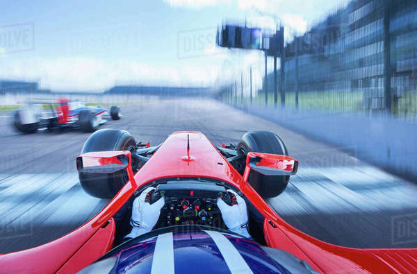 Personal perspective formula one race car driver speeding on race track Royalty-free stock photo