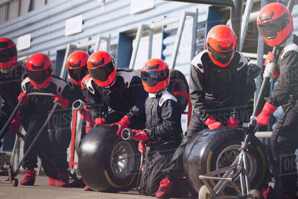 Pit crew ready with tires in formula one pit lane Royalty-free stock photo