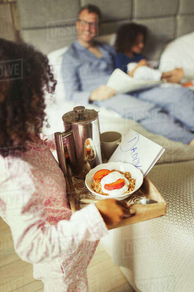 Girl serving breakfast in bed and card to father on Father's Day Royalty-free stock photo
